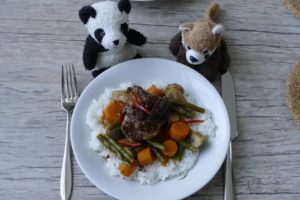 Colorful coconut vegetable curry with duck breast